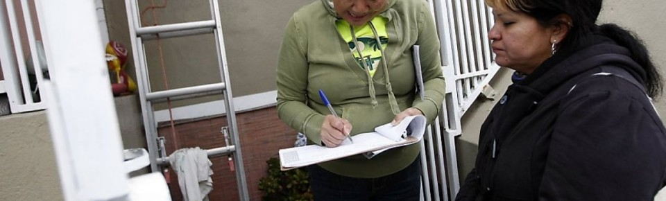 Jessica lets a voter fill out walk sheet